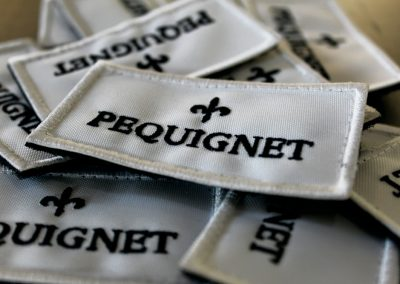 Pequignet – Ecusson
